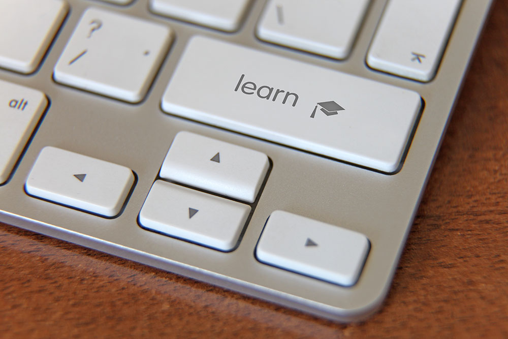 "Image of keyboard with a key labeled ""Learn"""